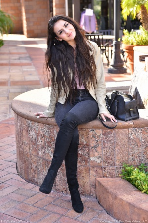 Beautiful Teen Coed with Wide Hips and Overknee Boots