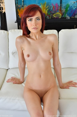 Busty Redhead with a Smoothly Shaved Pussy