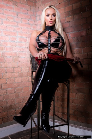 Dominant Woman in Latex Thigh Boots