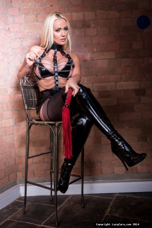 Busty Latex Domina in Overknee Boots