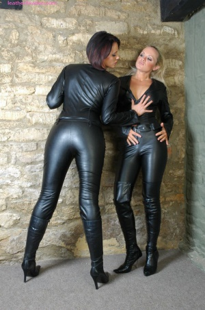 Fat Ass MILF Spreading in a Shiny Leather Catsuit