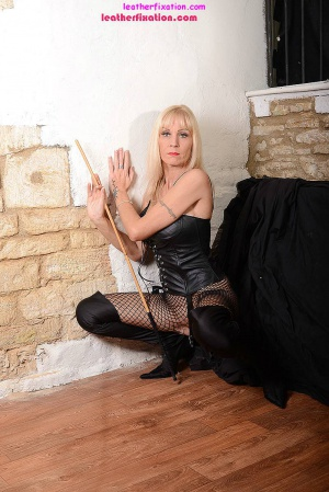 Curvy GILF in Fishnets and Thigh Boots