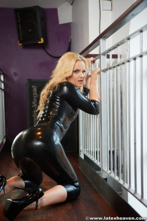 Blond Bubble Butt in a Latex Catsuit
