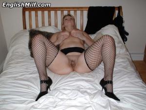 Huge Ass Spreading in Fishnet Stockings