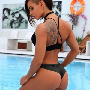 Perfect Tanned Ass on a Tattooed Slut