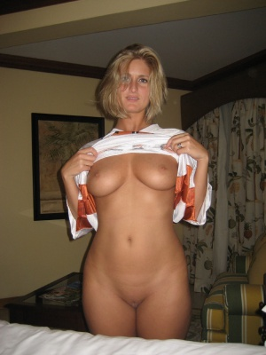 Tanned Hourglass MILF with a Shaved Pussy